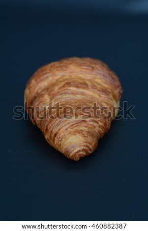isolated croissant on a black table