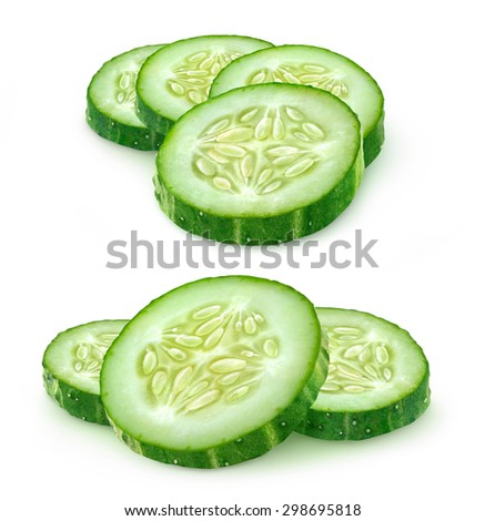 Isolated cucumber pieces. Slices of cucumber over white background, with clipping path - stock photo