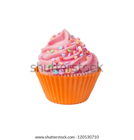 Isolated cupcake with pink whipped cream and sprinkles - stock photo