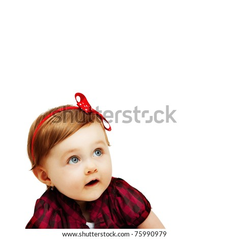 isolated cute baby girl looking up - stock photo