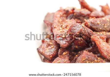Isolated deep fried beef slice with herbs with delicious taste on white background - stock photo