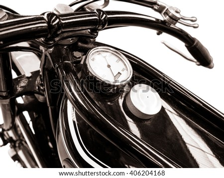 Isolated Detail Of A Vintage Motorbike With Fuel Tank And Speedometer - stock photo