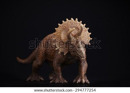 Isolated dinosaur on black background - stock photo