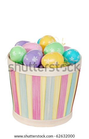 isolated Easter basket with colorful eggs