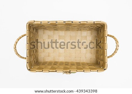 Isolated Empty Brown Wicker Handmade Crafts Basket on White Background View from Top or Above / Eco Friendly Material from Nature  - stock photo