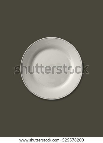 Isolated empty plate on solid brown color background