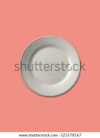 Isolated empty plate on solid peach color background