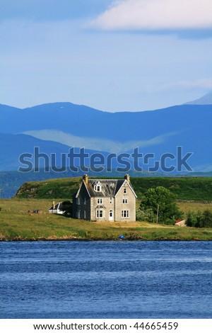 Isolated farmstead across Isle of Jura in the Scottish Highlands - stock photo