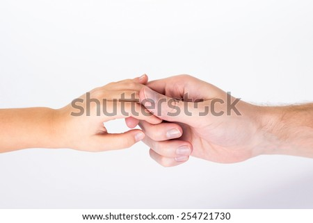 isolated father and child holding hands - stock photo