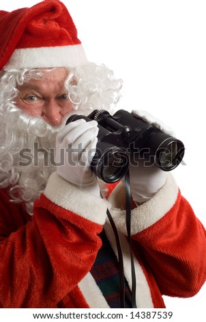 Isolated Father Christmas with a jolly look in his eye and binoculars - stock photo