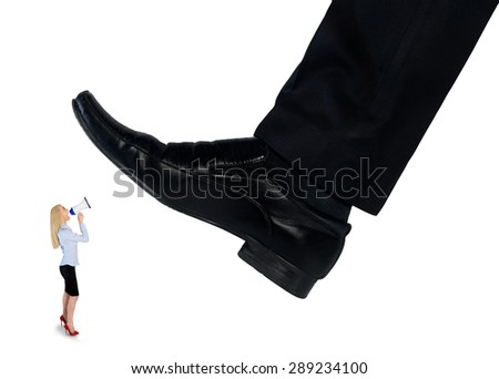 Isolated feet man crushing little business woman - stock photo