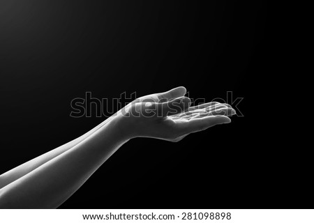 Isolated female empty open hand with palm raised upward in black and white color tone : Pray for support concept