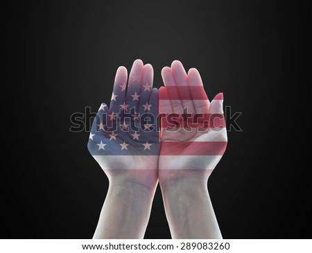 Isolated female human hands with open palms with double exposure of the United States of America flag pattern on black background : USA Independence day, columbus, day,flag day, labor day concept      - stock photo