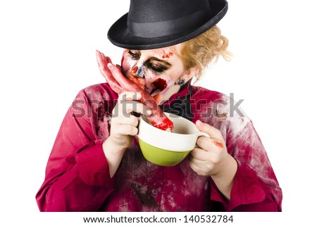 Isolated female zombie eating a bloody hand on white background
