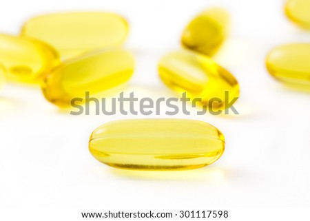 Isolated fish oil capsules - stock photo