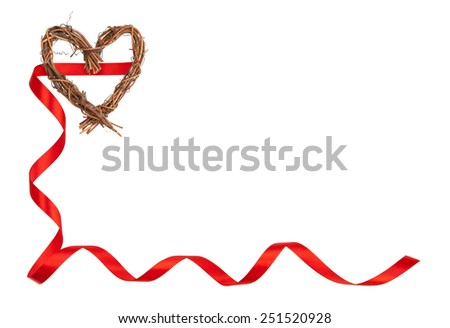 Isolated frame consisting of a handmade wooden heart and curled red ribbon with copy space. - stock photo