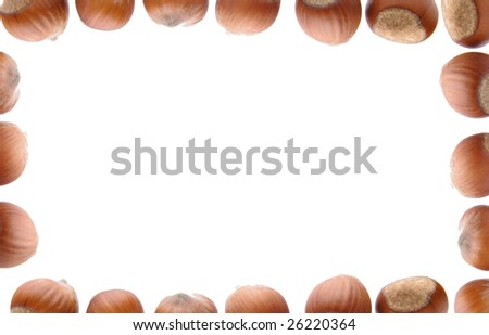 Isolated frame of hazelnuts - stock photo