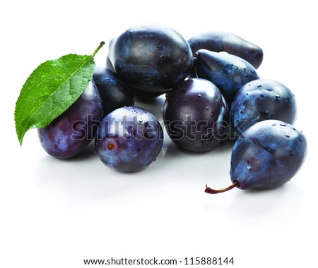 Isolated fresh plums with on white background - stock photo