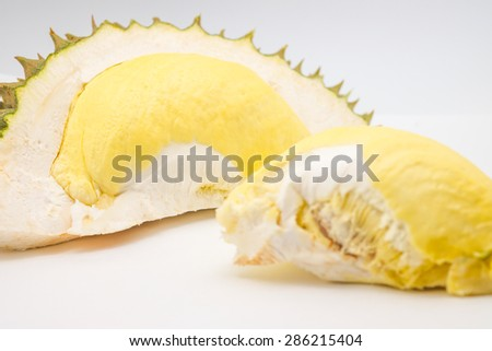 Isolated fresh tropical fruit, durian, king of fruits with yellow meat on white background - stock photo