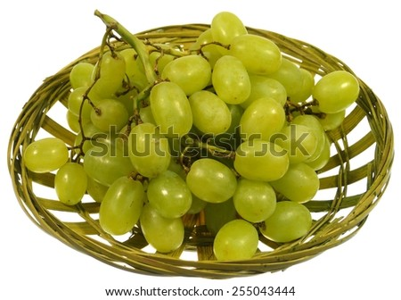 Isolated fresh white grapes in a basket - stock photo