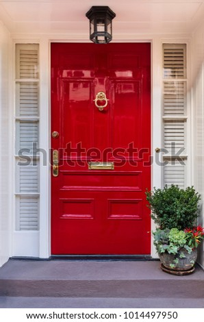 Isolated front red door of a house