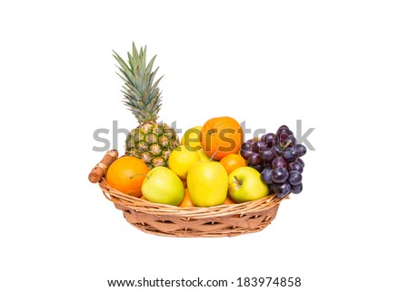 Isolated fruit basket with pineapple, oranges, lemons, apples and grapes
