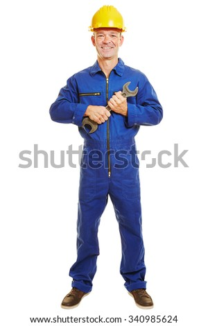 Isolated full body craftsman in boiler suit holding a jaw wrench - stock photo
