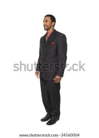 Isolated full length studio shot of a businessman facing slightly away from the camera.
