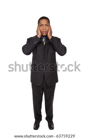 Isolated full length studio shot of a businessman in the Hear No Evil pose. - stock photo