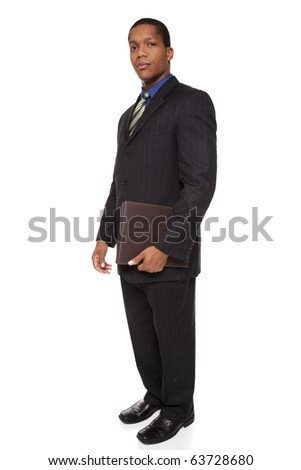 Isolated full length studio shot of a confident businessman looking at the camera while holding a notepad. - stock photo