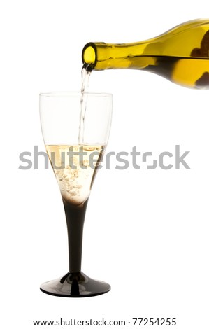 Isolated glass of white wine and the bottle