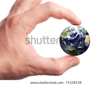 Isolated globe in man's fingers