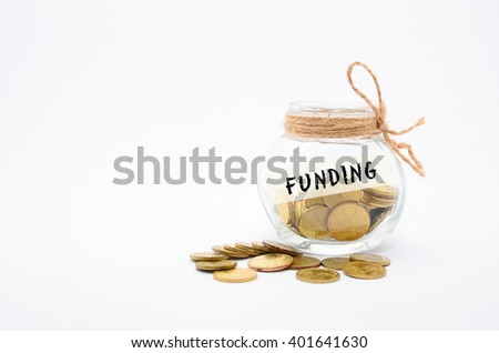 Isolated gold coins in jar with Funding label - financial concept