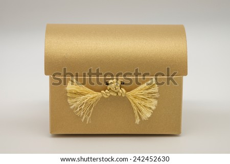Isolated golden color gift paper box with design for putting present, gift or treasure for special events such as birthday, Chinese New Year and Valentine's day - stock photo
