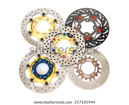 Isolated group of new disc brake for motorcycle on white background - stock photo