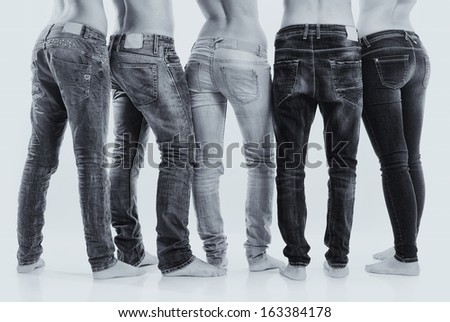 Isolated group of young men and women with jeans - stock photo