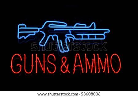 Isolated Gun and Ammo Neon Light Sign - stock photo