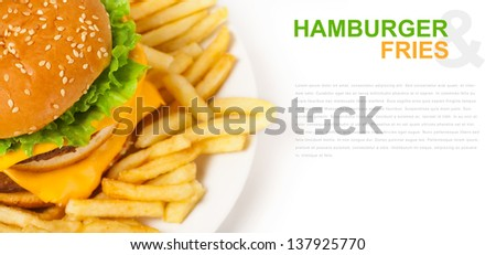 isolated hamburger and fries on plate and place for text - stock photo