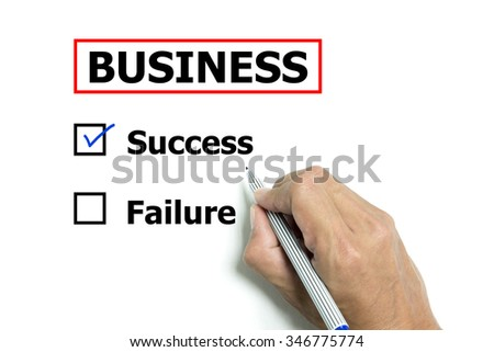 Isolated hand and pen to design business 'success or failure' on white paper background