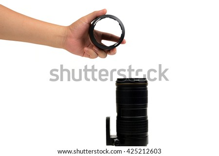 isolated hand holding lens hood for put into front of photo Lens
