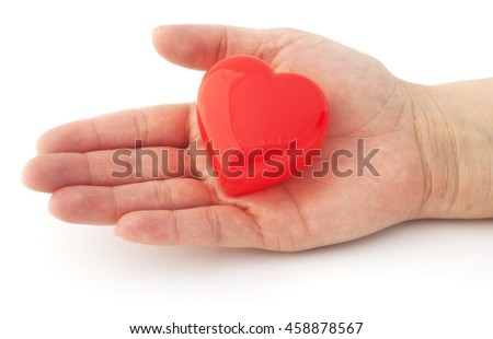 Isolated hand with a red heart. Helping hand.