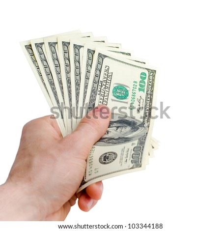 isolated hand with pack of one hundred dollars - stock photo