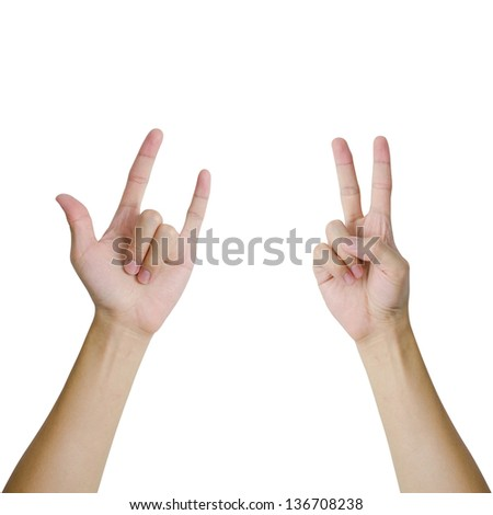 Isolated hands in a pose of love and peace sign - stock photo