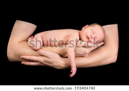 Isolated hands of a father holding his newborn baby girl - stock photo