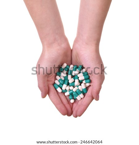 Isolated hands with pills