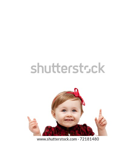 Isolated happy baby girl pointing up and above - stock photo