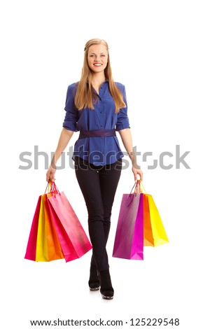 isolated happy blonde woman carrying shopping bags