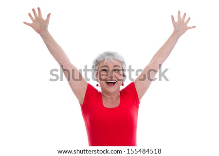 Isolated happy senior woman celebrating victory - stock photo