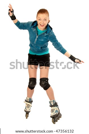 Isolated happy woman learning to use roller skates - stock photo