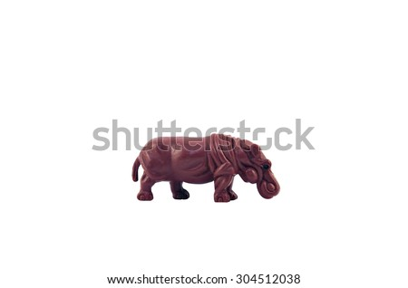 Isolated  hippopotamus toy. Isolated hippopotamus toy side view. - stock photo